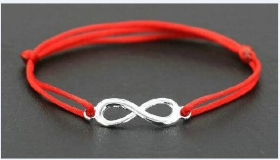 Красная нить со знаком бесконечности: что означает на запястье